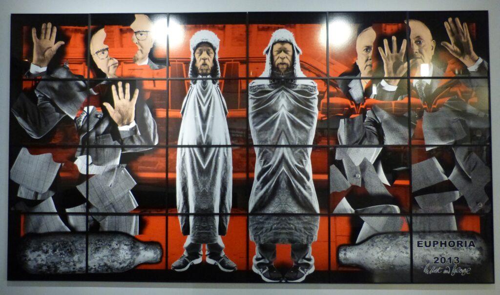 "Gilbert & George, Euphoria, 2013, aus der Serie ""Scapegoating Pictures"", Ausstellungsansicht St. Matthäus-Kirche Berlin, 2017. Foto © Urszula Usakowska-Wolff"